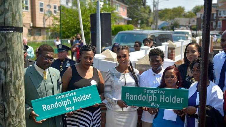 Holder family members stand during a street-renaming ceremony