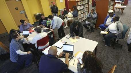 Affordable Care Act navigators hold an enrollment