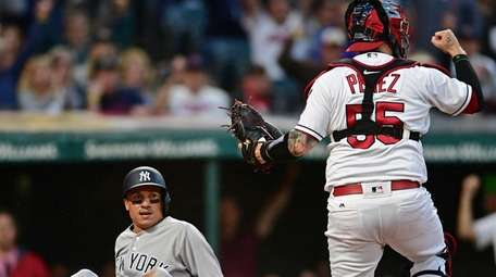 Cleveland Indians catcher Roberto Perez, right, celebrates after