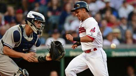 Indians' Michael Brantley scores on Edwin Encarnacion's sacrifice