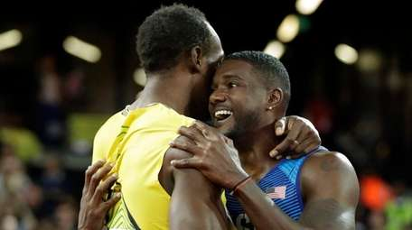 Gold medal winner United States' Justin Gatlin, right,