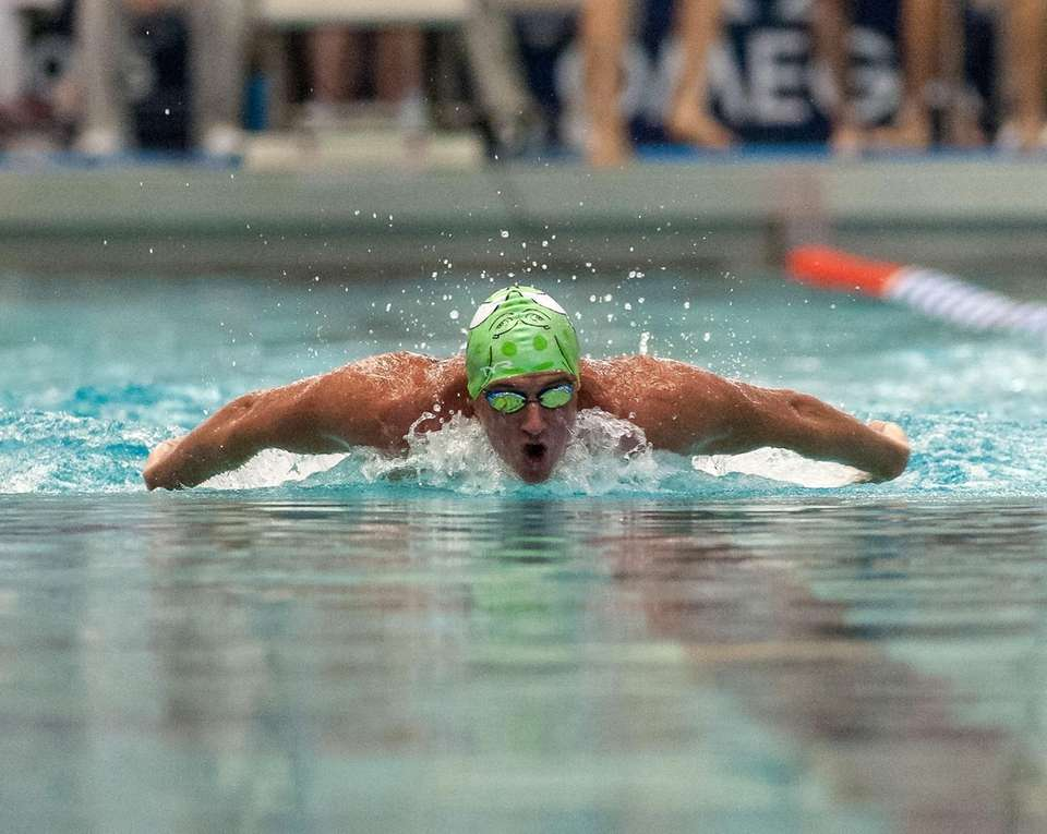 Ryan Lochte swims during the preliminaries of the