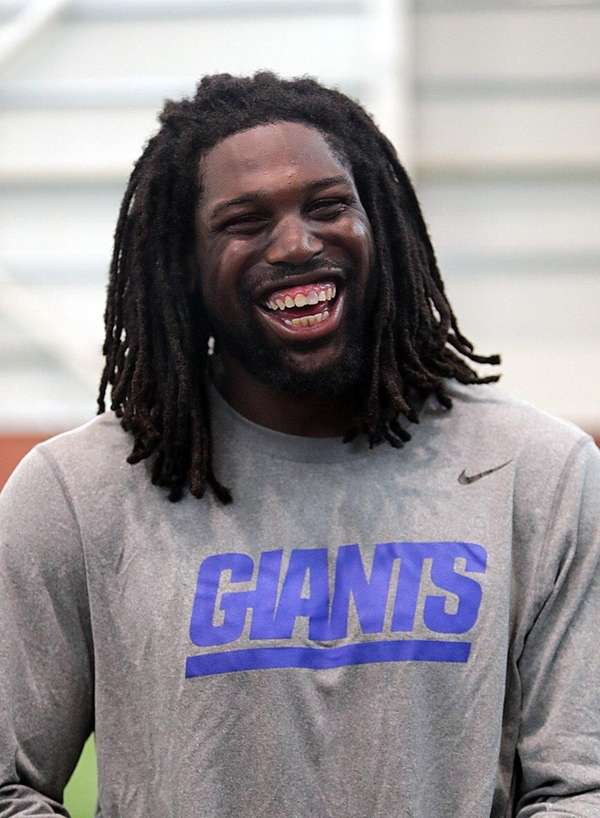 Giants defensive end Avery Moss speaks with the