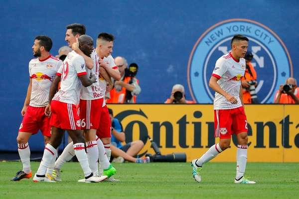 Bradley Wright-Phillips of the Red Bulls is congratulated