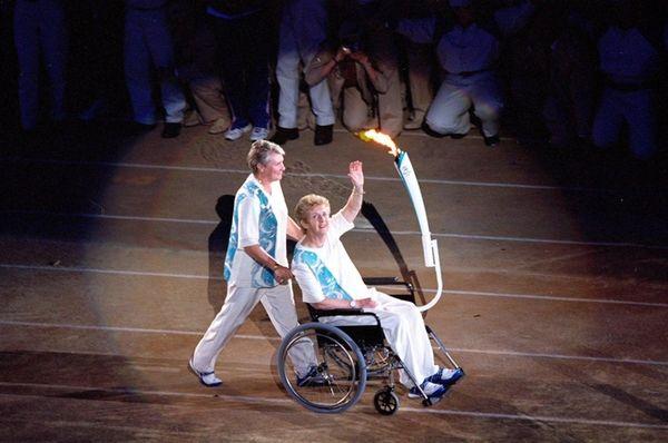 Torchbearers Betty Cuthbert is pushed by Raelene Boyle