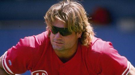 Darren Daulton of the Philadelphia Phillies streches before