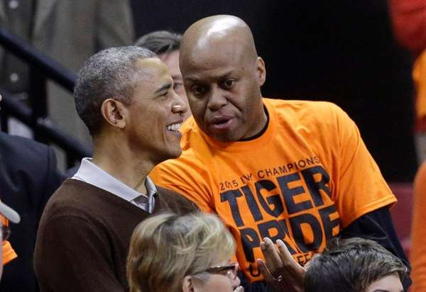 President Barack Obama chats with his brother-in-law Craig