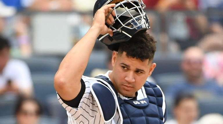Yankees catcher Gary Sanchez looks on against the