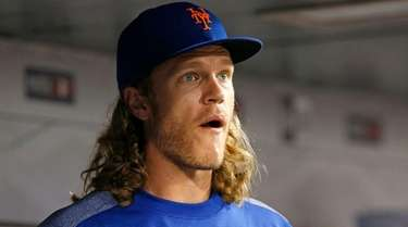 Mets pitcher Noah Syndergaard looks on during agame