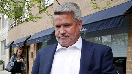 Fox News co-president Bill Shine, right, leaves a