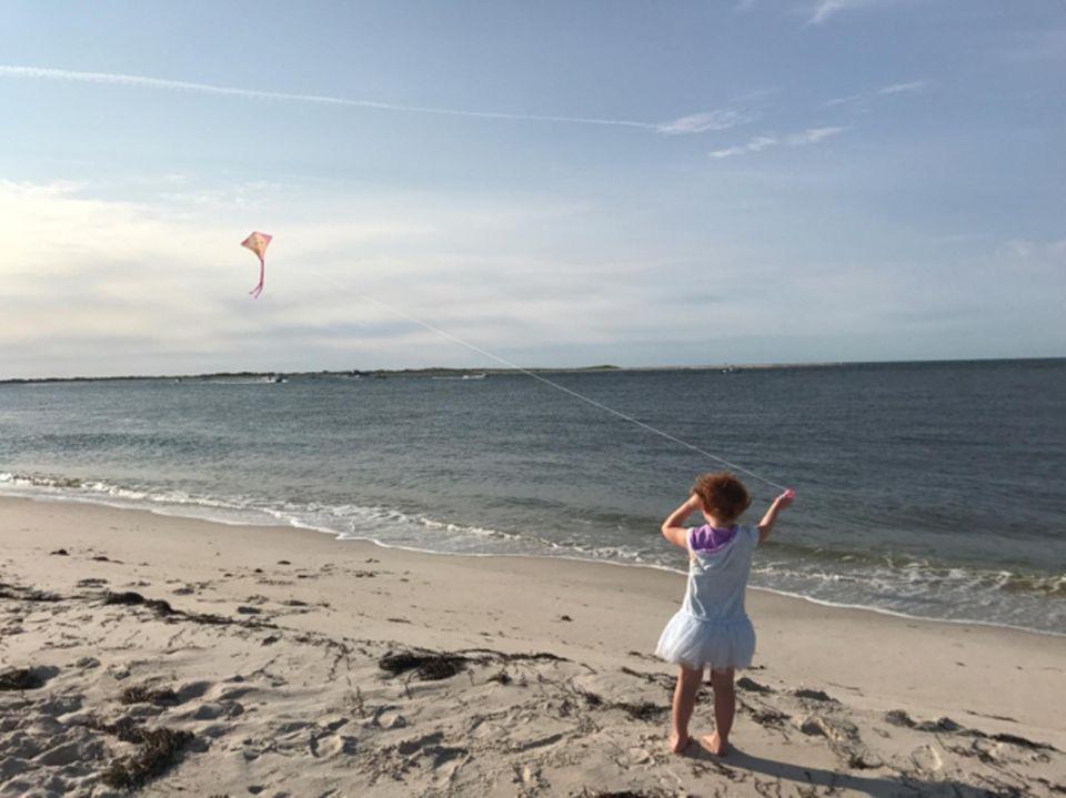 Kendall Baierlein flies a kite on a windy