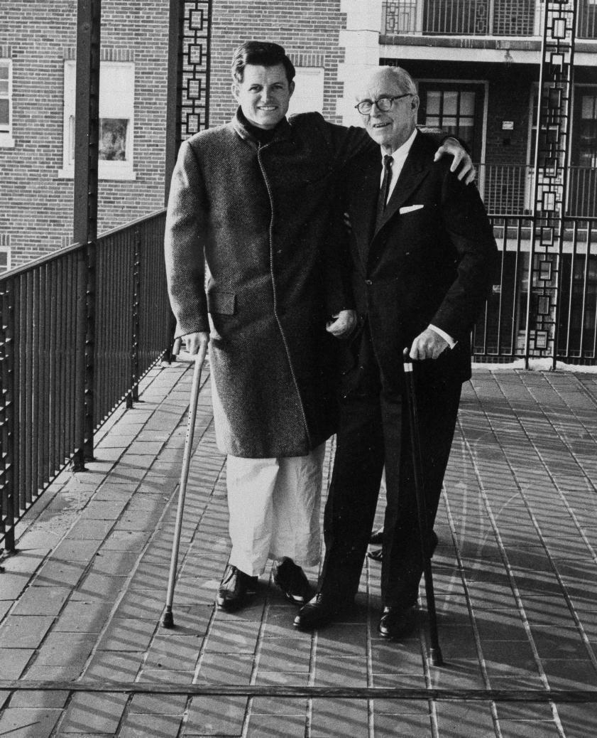 Sen. Edward M. Kennedy, left, takes a stroll