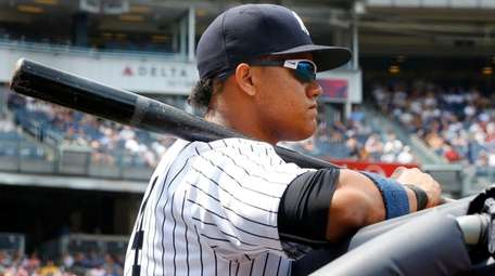 Yankees second baseman Starlin Castro looks on during