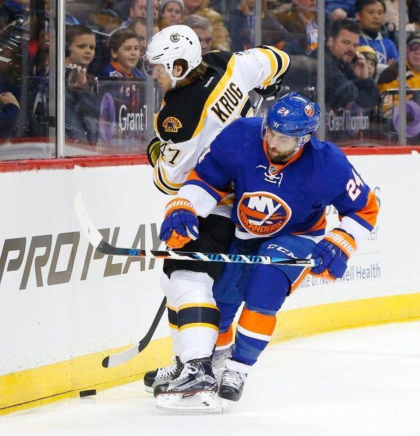 Islanders forward Stephen Gionta battles for the puck