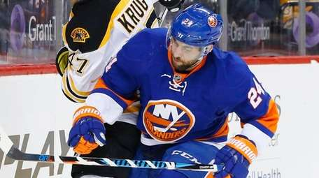 Islanders forward Stephen Gionta  battles for the puck