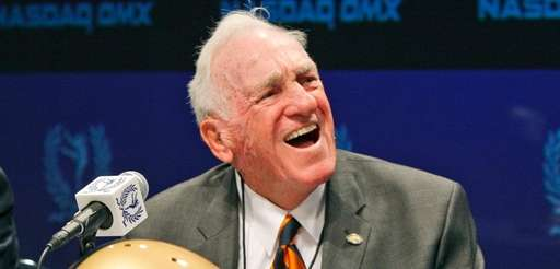 Former Syracuse and Massachusetts coach Dick MacPherson laughs