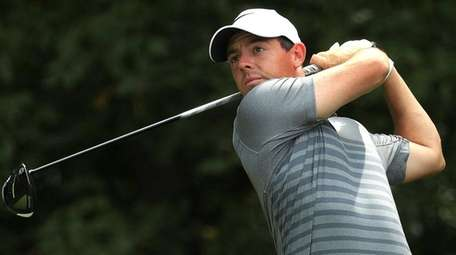 Rory McIlroy plays his shot during a practice