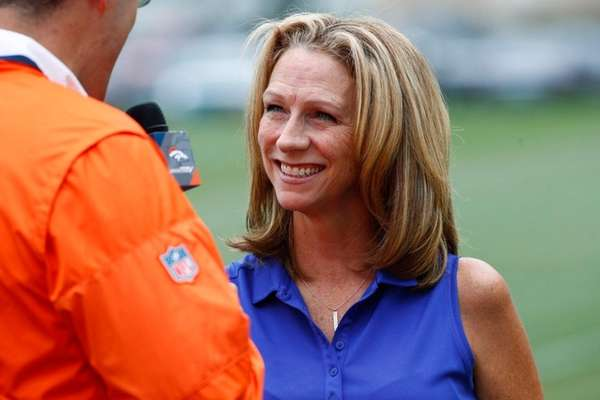 Broadcaster Beth Mowins chats with a reporter while