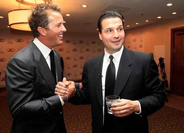 Eddie Olczyk, right, and Mike Modano shake hands