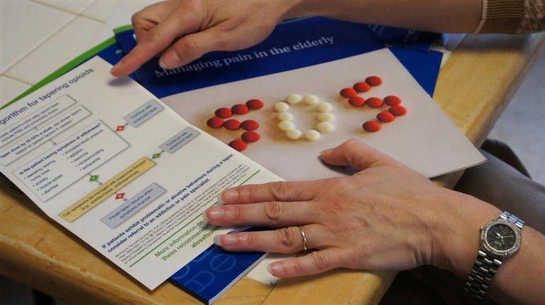 A nurse educator explains educational materials on opioids