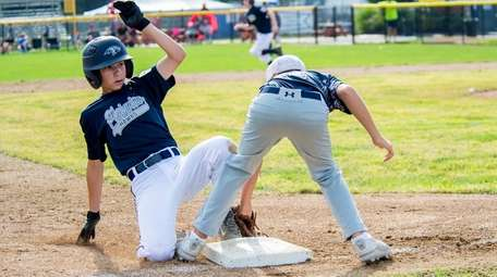 Plainview's Tyler Ciulla slides safely into third during