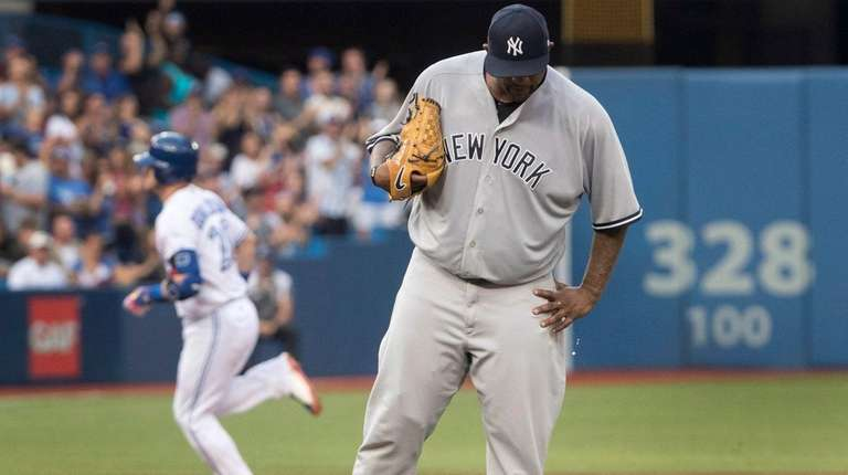 Yankees pitcher CC Sabathia walks off the mound after