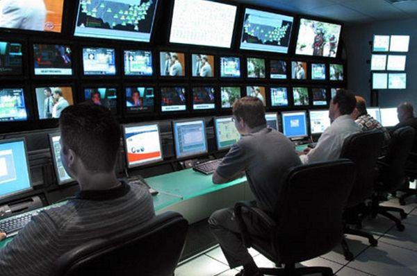 Technicians operate the control console in the control