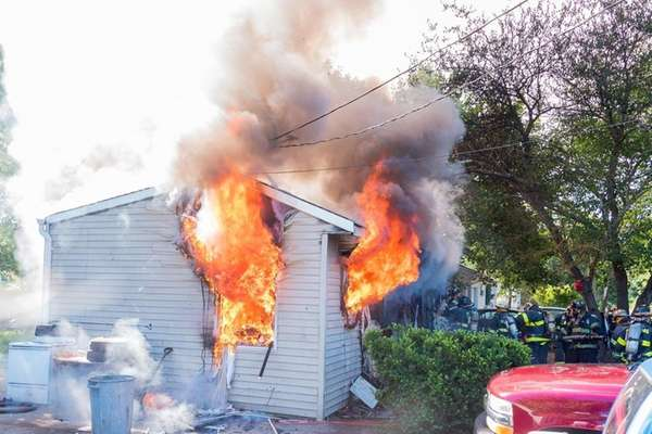 Firefighters respond to a house fire on Bayview