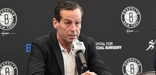 Nets head coach Kenny Atkinson answers questions from