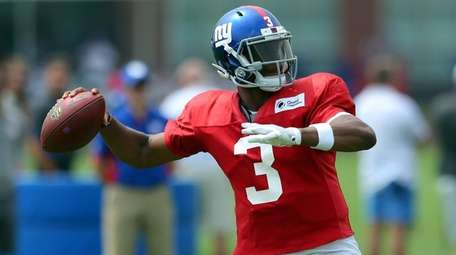 New York Giants' Geno Smith throws a pass