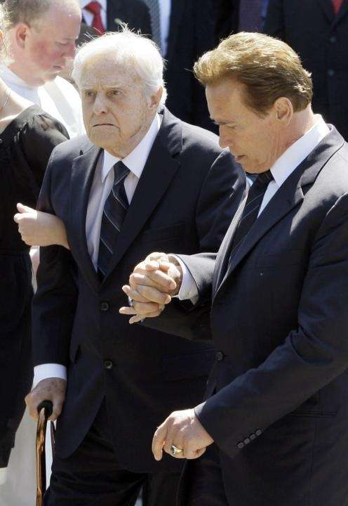 California Gov. Arnold Schwarzenegger, assists his father-in-law Sargent