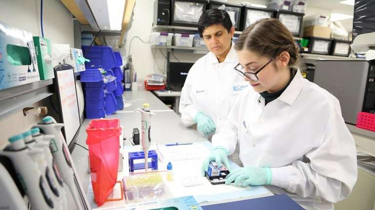 Junior scientist Melissa Ahrens, right, and research and