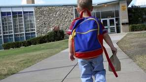 A child walking into kindergarten.