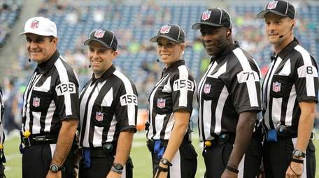 Some of the NFL football officials working a