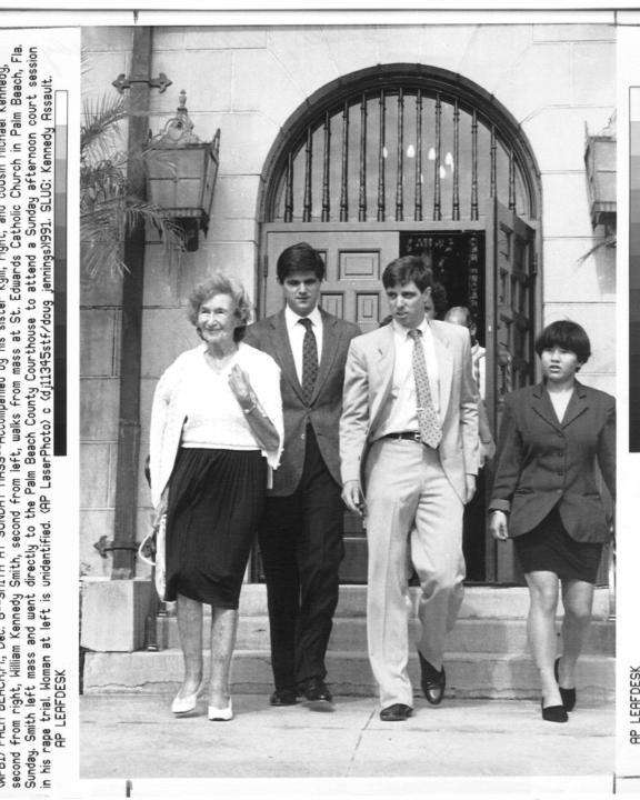 William Kennedy Smith, second from left walks from