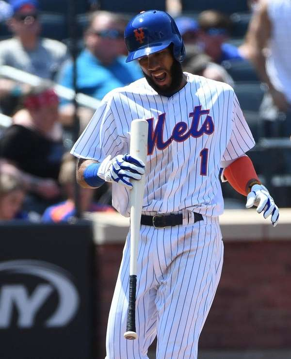 Mets shortstop Amed Rosario reacts after he strikes