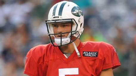 Christian Hackenberg heads to the sideline during the