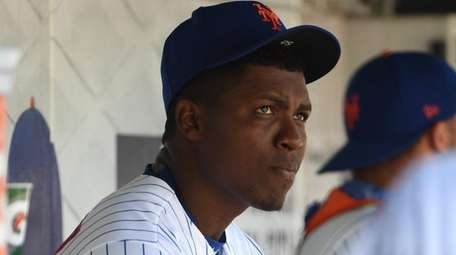 Mets pitcher Rafael Montero looks on from the