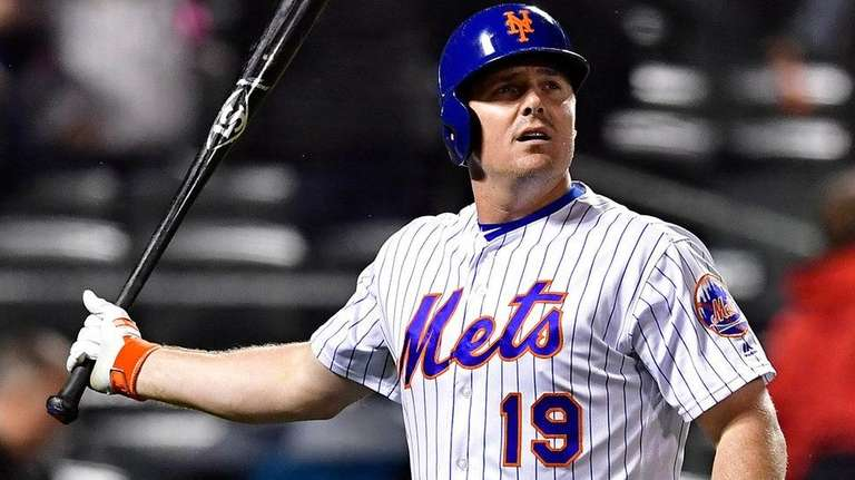 Jay Bruceof the Mets reacts after flying out