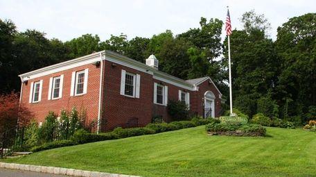 Flower Hill Village Hall is seen on July
