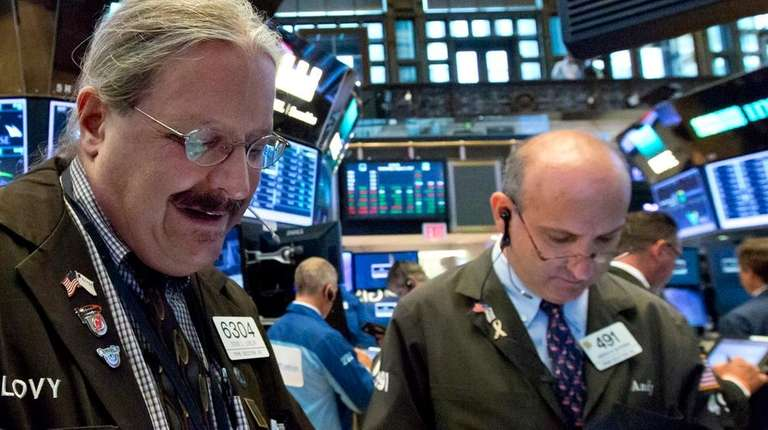 Traders Steve Lovejoy, left, and Andrew Silverman at