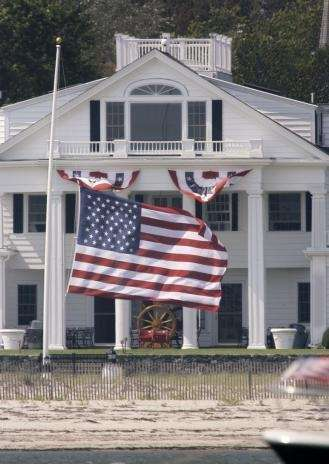 A large flag flies at half-staff outside the