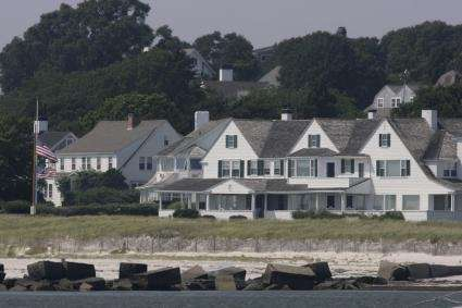 Flags fly at half-staff outside the Kennedy family