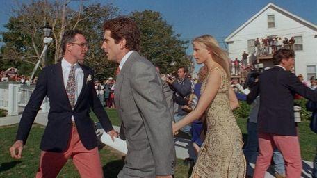 John Kennedy and actress Daryl Hannah walk swiftly