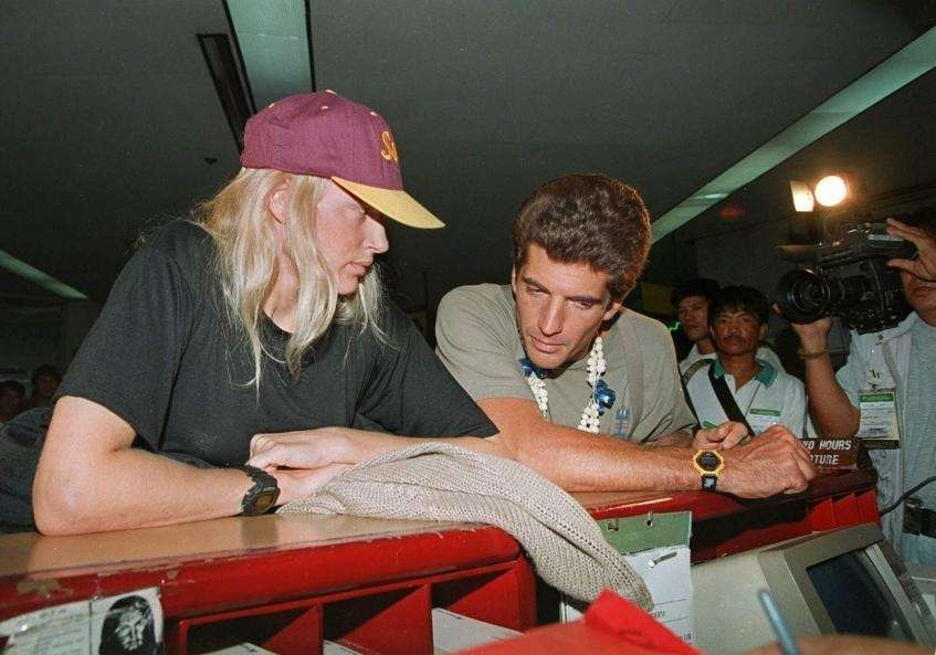 John Kennedy Jr. talks to Daryl Hannah as