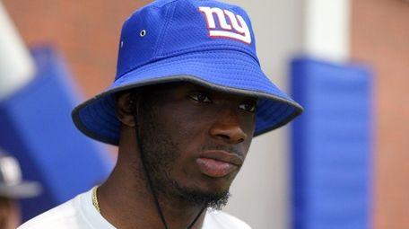 Giants safety Mykkele Thompsontalks to the media during