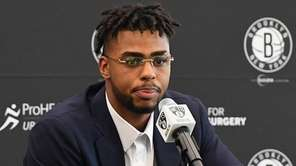 Nets' D'Angelo Russell answers questions during a