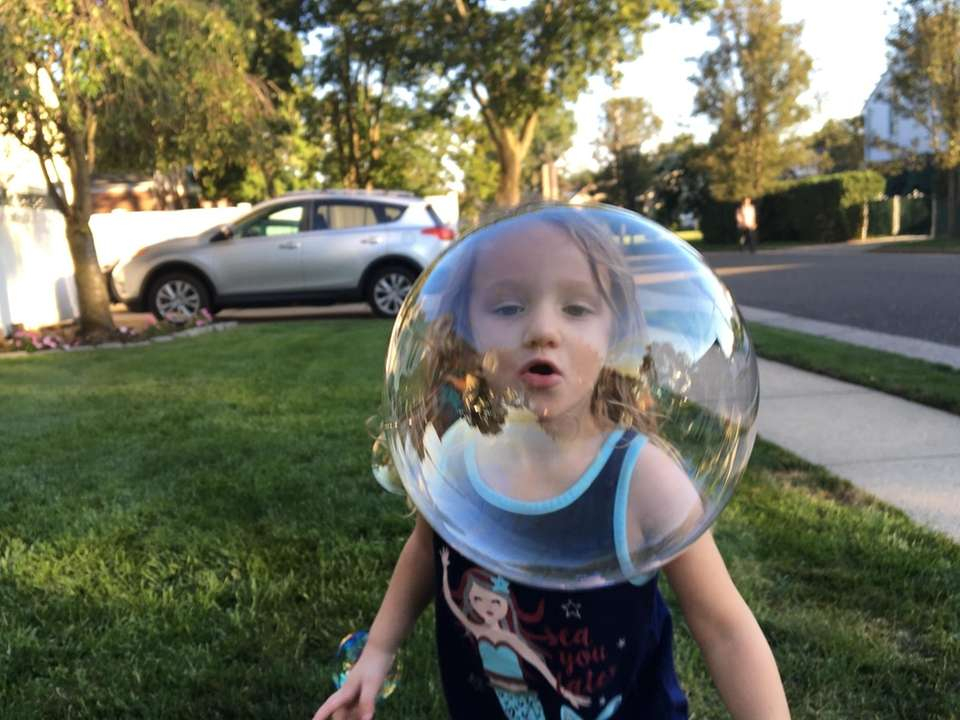 Emma enjoying the summer with giant bubbles.