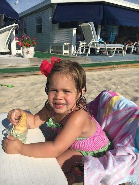Isabella enjoying some ice cream at the beach!