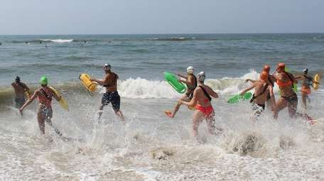 Junior lifeguards enter the water during the rescue